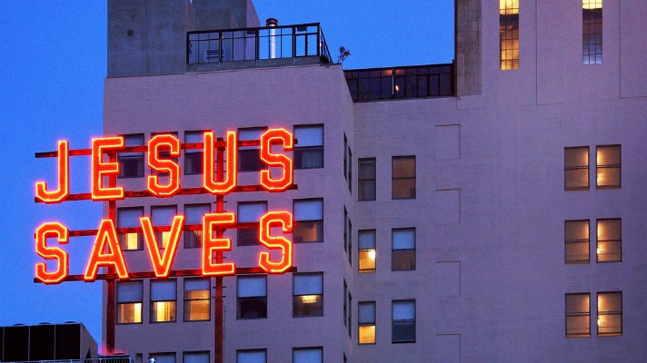 """""""Jesus Saves"""" neon sign at the Ace Hotel Downtown Los Angeles"""