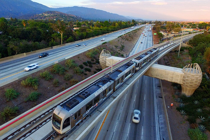 Metro Gold Line test train heads over eastbound 210 Freeway toward Arcadia Station